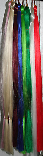 silky braid in natural and fun party colors. This photo shows white, red, blue, pink and more kanekalon silky braid