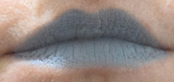 Matte light grey lipstick Steel Heart shown on the lips